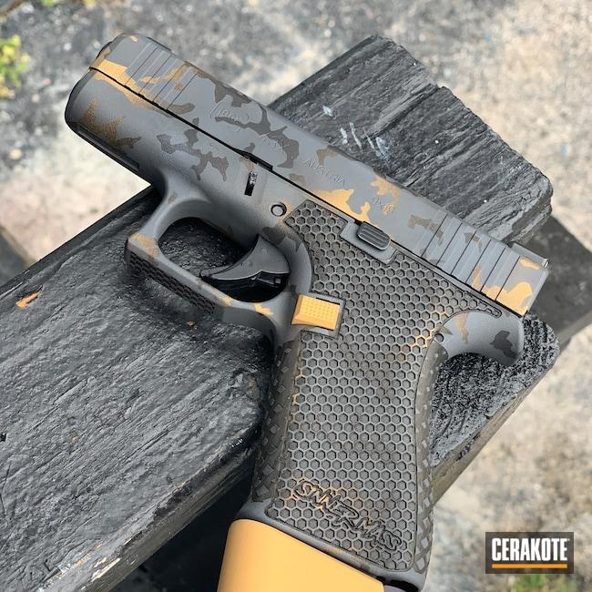 Cerakoted: S.H.O.T,Glock 43X,Laser Stippled,g43x,Stippled,Pistol,Laser Engrave,Urban Camo,EDC,Black and Gold,Custom Camo,Gold H-122,9mm,Sniper Grey H-234,MultiCam,Graphite Black H-146,Glock,Urban Multicam,Black Multi Cam