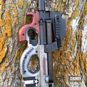 Cerakoted H-152 Stainless With H-190 Armor Black With H-171 Nra Blue With H-221 Crimson With H-147 Satin Mag And H-136 Snow White