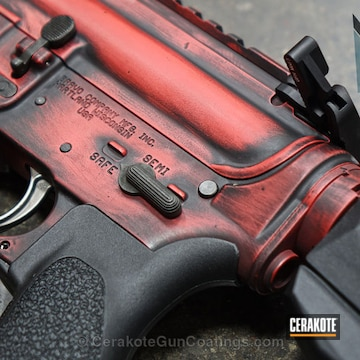 Cerakoted H-216 Smith & Wesson Red And H-190 Armor Black