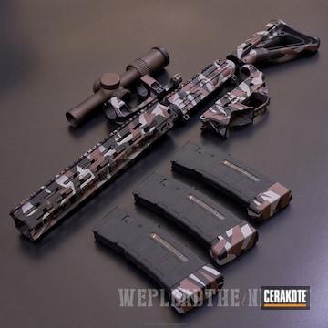 Cerakoted H-146 Graphite Black, H-214 Smith & Wesson Grey And H-293 Vortex Bronze