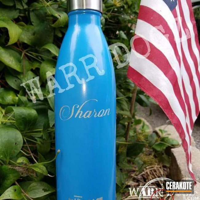 Smaller version of the 2nd project picture. Not Just Guns, Aluminum Water Bottle, Savage Stainless H-150Q, Sea Blue H-172Q, Crushed Silver H-255Q, Celtic Cross, High Gloss Armor Clear H-300Q