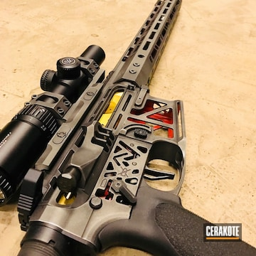 Cerakoted H-190 Armor Black, H-216 Smith & Wesson Red And H-237 Tungsten