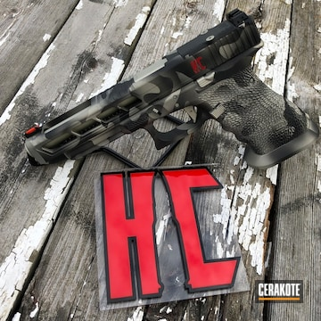 Cerakoted H-146 Graphite Black, H-153 Shimmer Gold And H-216 Smith & Wesson Red