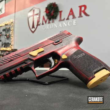 Cerakoted H-216 Smith & Wesson Red, H-190 Armor Black And H-122 Gold
