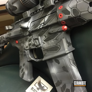 Cerakoted H-190 Armor Black With H-184 Glock Grey, H-213 Battleship Grey And H-216 Smith & Wesson Red