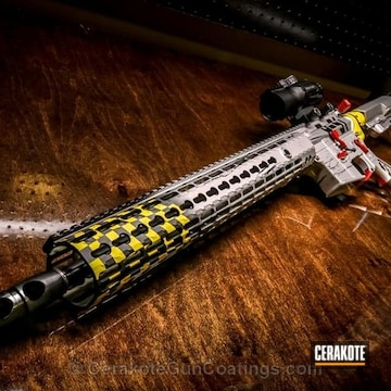Cerakoted H-216 Smith & Wesson Red, H-144 Corvette Yellow, H-158 Shimmer Aluminum And H-109 Gloss Black