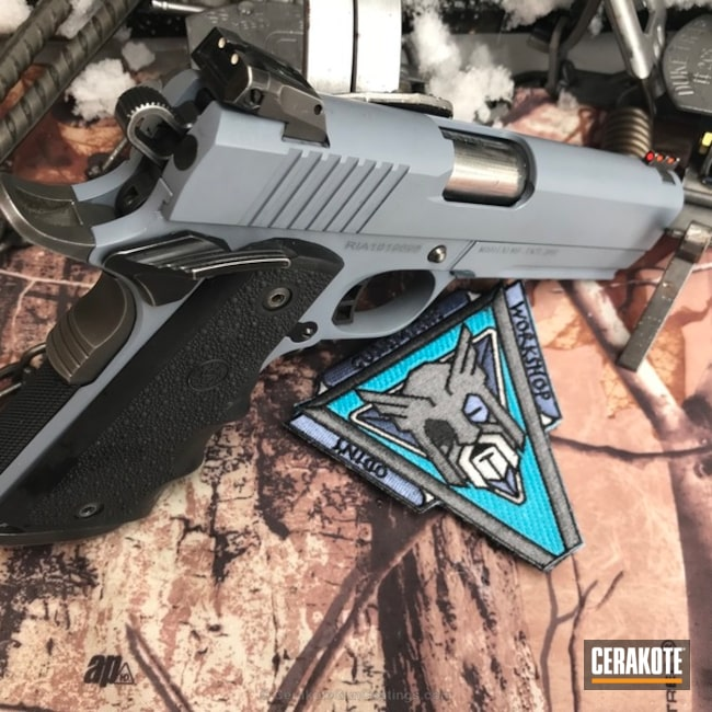 Rock Island Armory 1911 Handgun coated in Cerakote's Armor Black and Battleship Grey