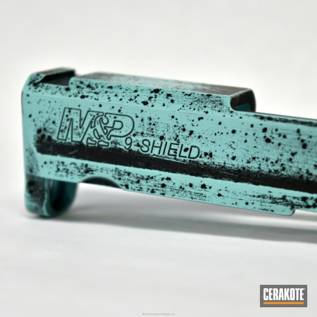 Smith & Wesson Pistol Slide coated in Cerakote's Graphite Black and Robin's Egg Blue