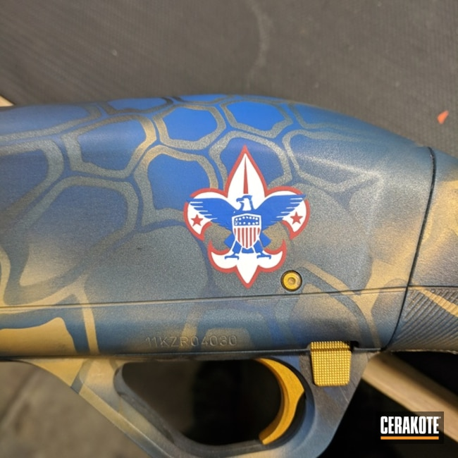 Winchester Shotgun coated in a Bluish/Gold Kryptek Pattern