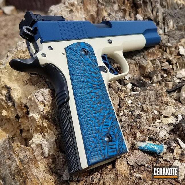 Ruger 1911 Handgun coated in a Benelli Sand and Kel-Tec Navy Blue Finish