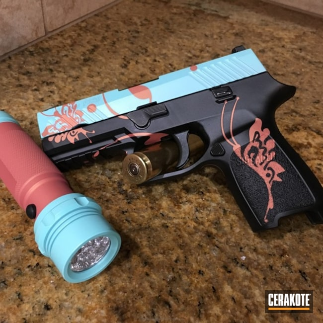 Matching Sig P320 Handgun and Flashlight done in a Robin's Egg Blue and Graphite Black Finish