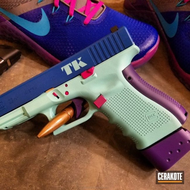 Thumbnail version of the 2nd project picture. Glock, Pistol, Ladies, Stencil, Glock 23, Graphics, Ridgeway Blue H-220Q, Robin's Egg Blue H-175Q, Sig Pink H-224Q, Wild Purple H-197, Custom Theme, College Theme, Sports Theme, Daily Carry, Nike