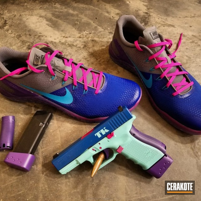 Thumbnail version of the 4th project picture. Glock, Pistol, Ladies, Stencil, Glock 23, Graphics, Ridgeway Blue H-220Q, Robin's Egg Blue H-175Q, Sig Pink H-224Q, Wild Purple H-197, Custom Theme, College Theme, Sports Theme, Daily Carry, Nike