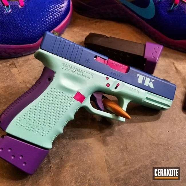 Big version of the 3rd project picture. Glock, Pistol, Ladies, Stencil, Glock 23, Graphics, Ridgeway Blue H-220Q, Robin's Egg Blue H-175Q, Sig Pink H-224Q, Wild Purple H-197, Custom Theme, College Theme, Sports Theme, Daily Carry, Nike