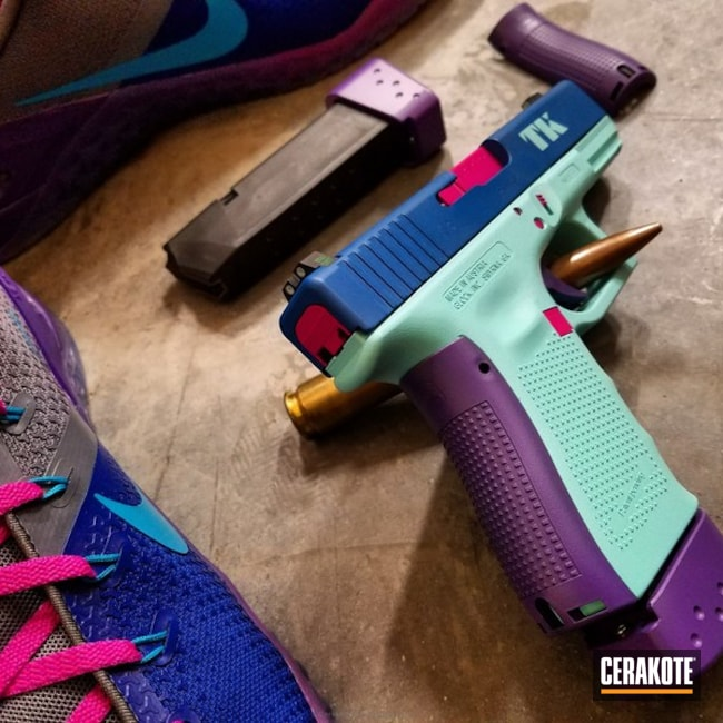 Smaller version of the 4th project picture. Glock, Pistol, Ladies, Stencil, Glock 23, Graphics, Ridgeway Blue H-220Q, Robin's Egg Blue H-175Q, Sig Pink H-224Q, Wild Purple H-197, Custom Theme, College Theme, Sports Theme, Daily Carry, Nike