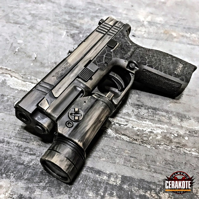 Springfield XD coated in H-146 Graphite Black and H-265 Flat Dark Earth