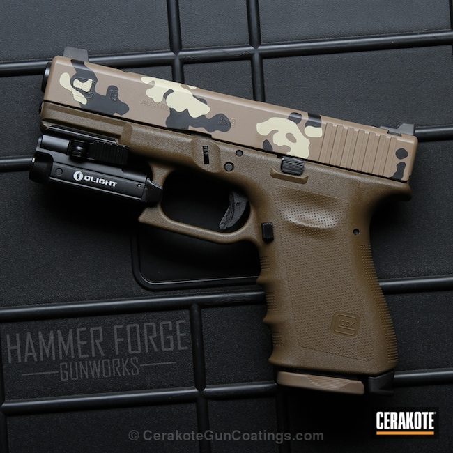 Glock 19 Handgun coated in a custom Cerakote ERDL Pattern