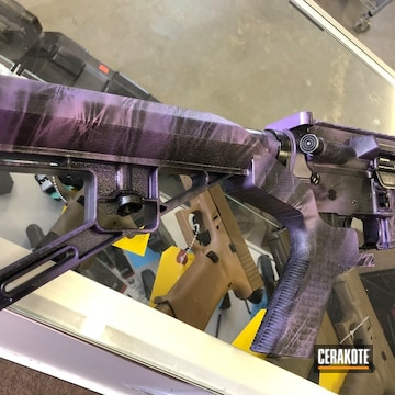 Cerakoted Dpms Rifle In A Marbled Camo Finish