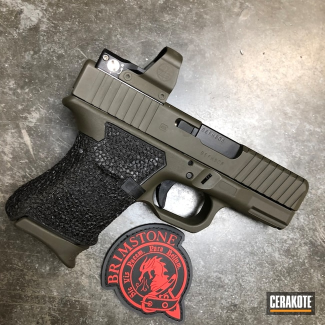 Glock coated in H-232 MagPul O.D. Green