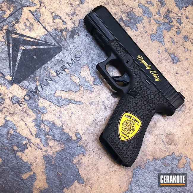 Glock 17 Handgun with H-122 Gold Accents