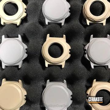 Cerakoted Undone Watch Frames In H-199 Desert Sand And H-139 Steel Grey