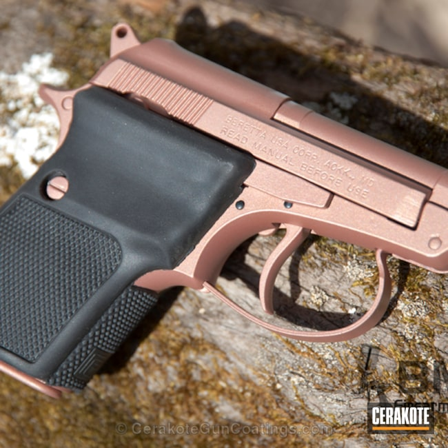 Beretta Handgun in a Rose Gold Cerakote Finish