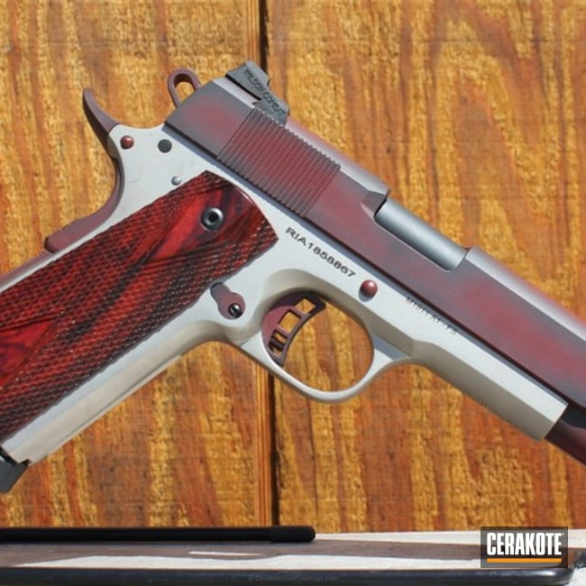 Rock Island Armory 1911 Handgun coated in H-146 Graphite Black and H-216 Smith & Wesson Red