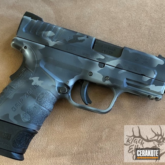 "Thumbnail image for project ""Springfield XD Handgun coated in a Black Multi Cam Finish"""