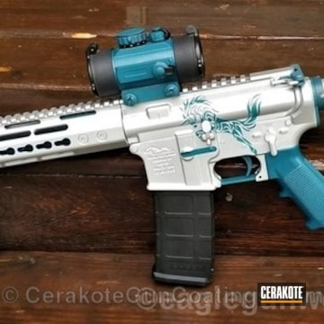 Cerakoted Anderson Mfg. Tactical Rifle Coated In H-401 Jesse James Civil Defense Blue And H-151 Satin Aluminum