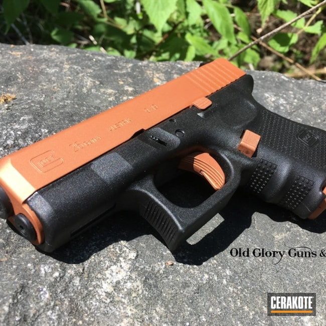 Glock 26 Handgun in a Custom Burnt Orange Cerakote Finish