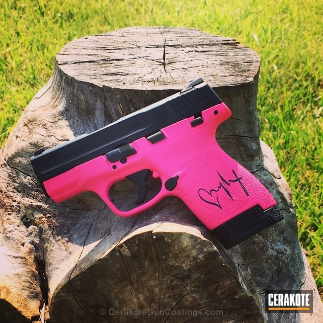 Two Toned Pink and Black Smith & Wesson Handgun
