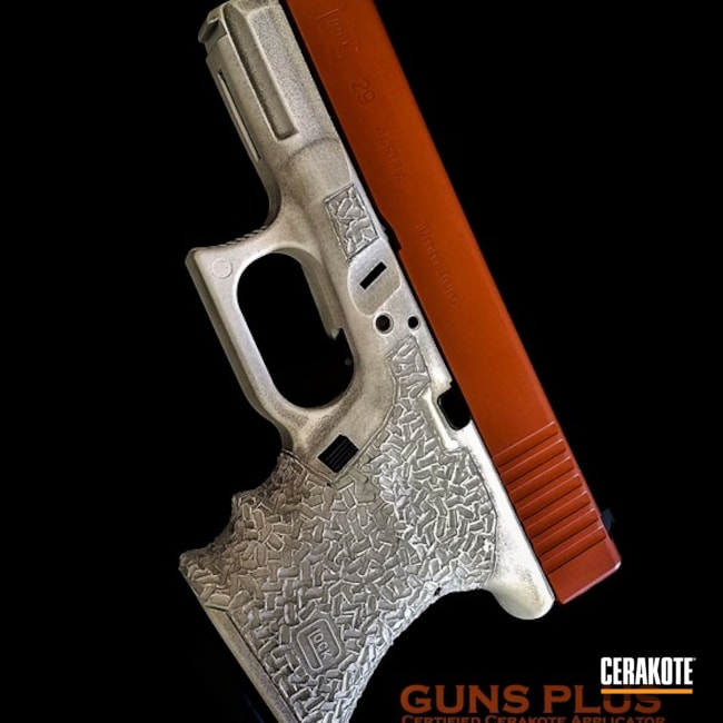 Glock 29 Handgun Coated in H-146 Graphite Black, H-136 Snow White and H-128 Hunter Orange