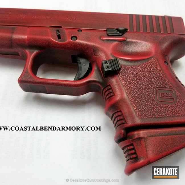 Glock 26 in a Distressed Red and Black Cerakote Finish