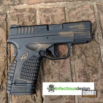 Cerakoted Springfield Xd Handgun Coated In A Distressed Graphite Black And Burnt Bronze Finish