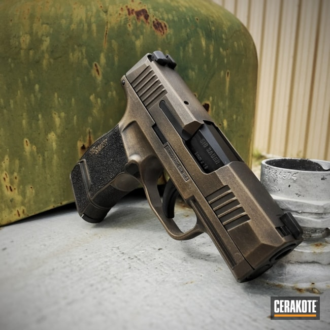 Distressed Sig Sauer Handgun coated in H-148 Burnt Bronze and H-146 Graphite Black