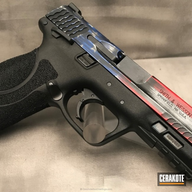 Smith & Wesson M&P Handgun coated in an American Flag Finish