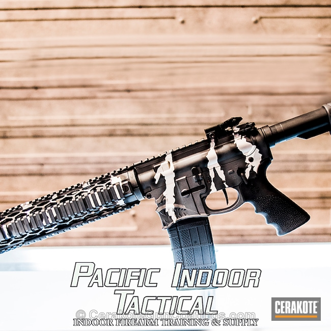 Spike's Tactical Rifle customized in a Cerakote Torn Camo Finish