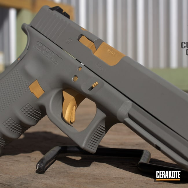 Two Toned Glock 22 in Cerakote Gold and Smith & Wesson Grey