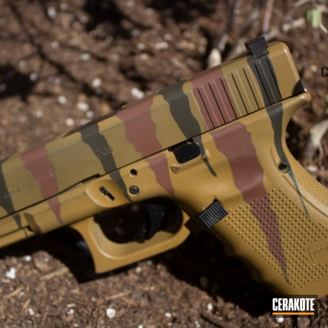 Custom Jurassic Park Rip Camo done on this Glock 19 Handgun