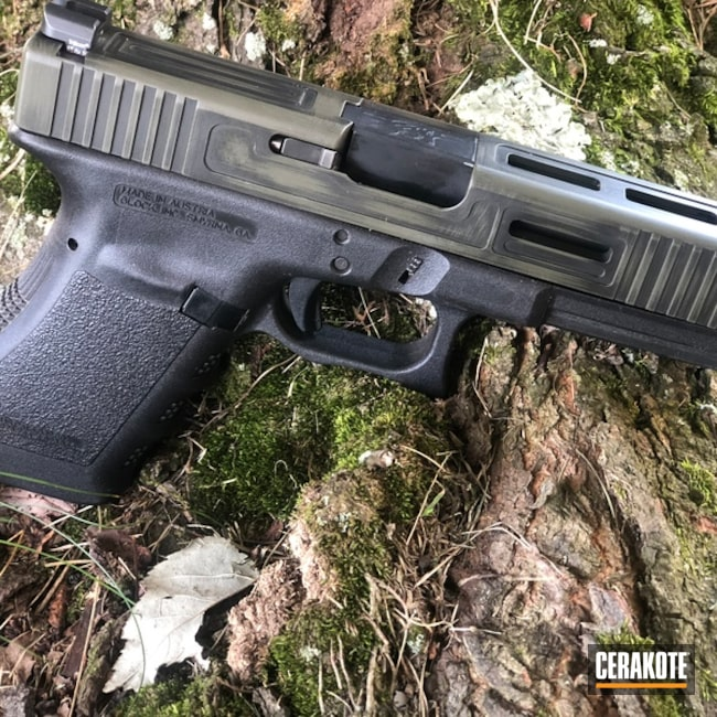 Battleworn Glock Handgun coated in Graphite Black and Mil Spec O.D. Green
