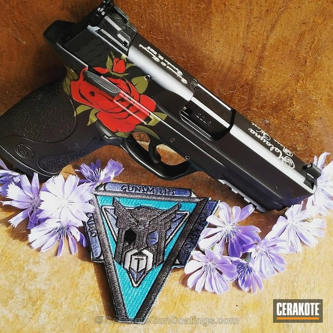 Smith & Wesson M&P Handgun coated in a Cerakote Rose Pattern