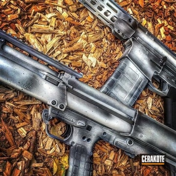 Cerakoted Matching Tactical Shotgun And Tactical Rifle Done In A Distressed Cerakote Finish
