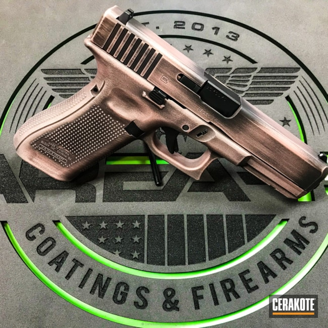 Distressed Rose Gold Glock Handgun