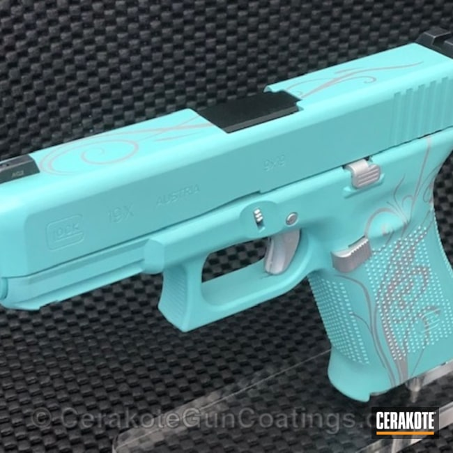 Glock 19 in a Satin Aluminum and Robin's Egg Blue Finish