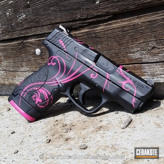 Smith & Wesson M&P Shield done in a Graphite Black and Bazooka Pink Finish