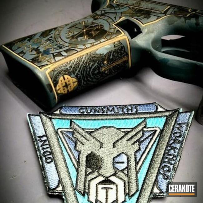 Cerakoted: Laser Stippled,Glock 19,Frame,Stippled,Armor Black H-190,Glock,Laser Engrave,COBALT KINETICS SLATE H-295,Gold H-122,Blue Titanium H-185