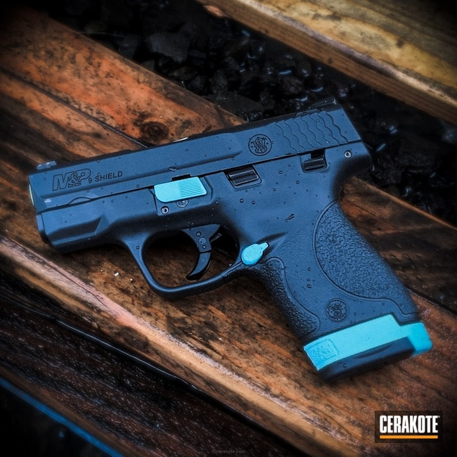 Smith and Wesson Shield with Elite Smoke and Robin's Egg Blue