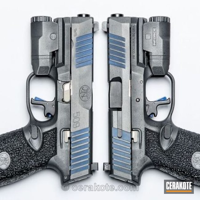 Two FN 509 Pistols with Graphite Black, NRA Blue and Titanium