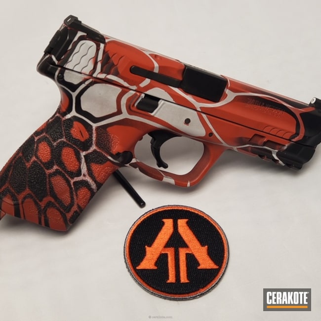 S&W Handgun in a Red, White and Black Kryptek Finish
