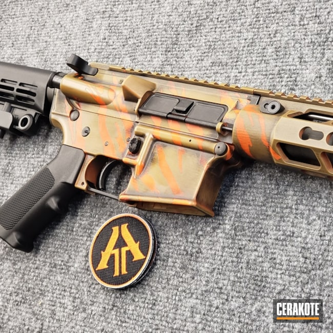 Thumbnail version of the 4th project picture. Graphite Black H-146Q, Anderson Mfg., Distressed, Battleworn, AR-15, Rifle, Tactical Rifle, Burnt Bronze H-148Q, 5.56, Hunter Orange H-128Q